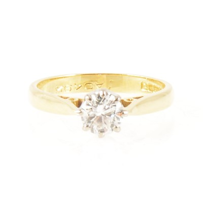 Lot 2-A diamond solitaire ring.