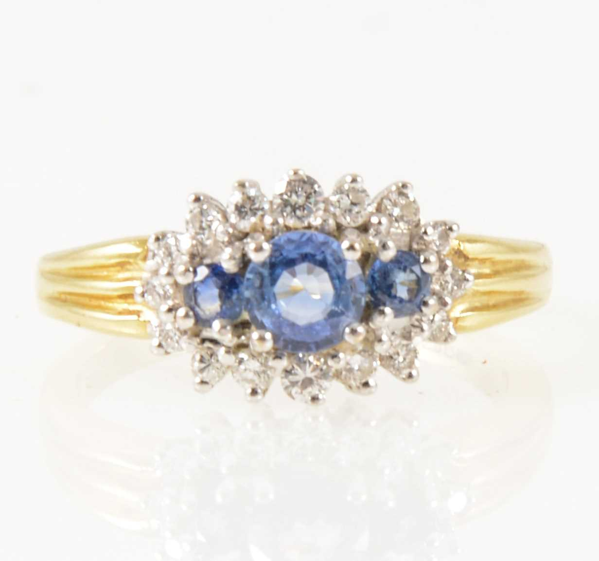 Lot 20-A sapphire and diamond boat shape cluster ring.
