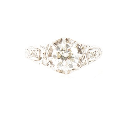 Lot 1-A diamond solitaire ring.