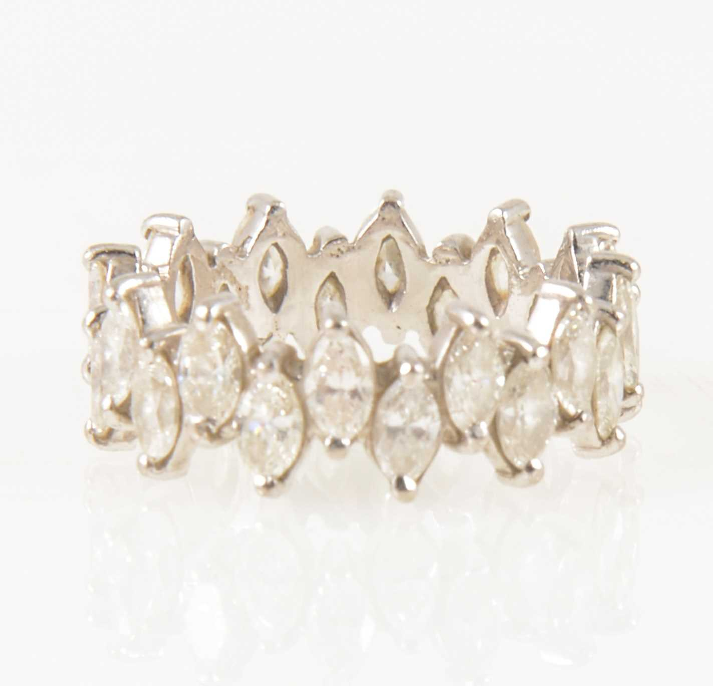 Lot 14-A marquise cut diamond full eternity ring.
