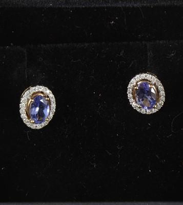 Lot 55-A pair of tanzanite and diamond earstuds.