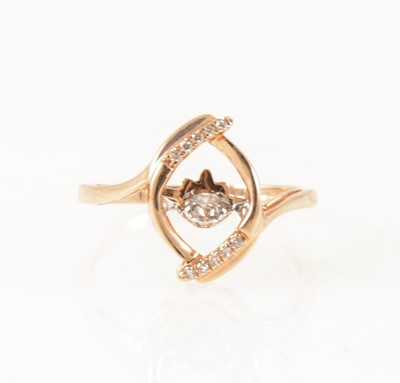 Lot 50-A dancing diamond dress ring.