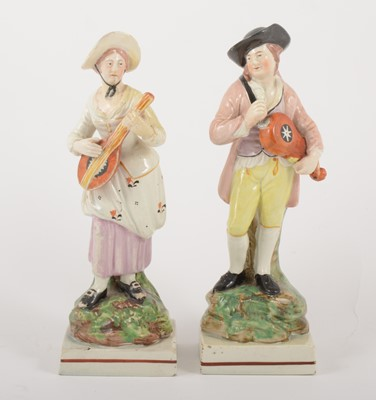 Lot 2-A pair of Staffordshire pearl glazed earthenware figurines