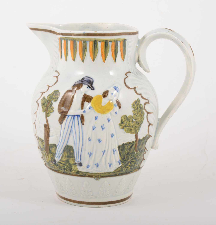 Lot 5-A Prattware jug, Sailor's Farewell, early 19th century
