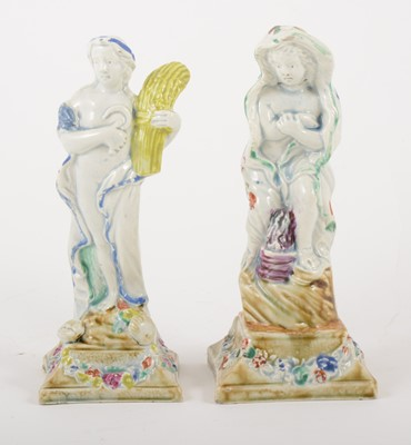 Lot 6-Two pearlware figures, emblematic of Autumn and Winter, late 18th century