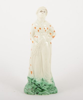 Lot 8-A creamware figure of a lady, late 18th century