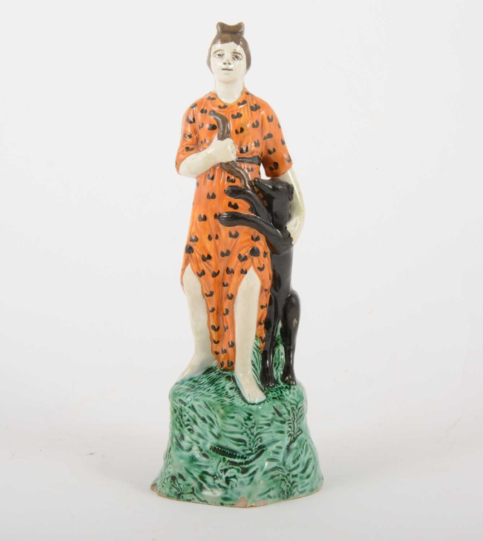Lot 3-A Staffordshire lead-glazed earthenware figure