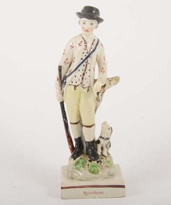 Lot 9-A Staffordshire earthenware figure of a Sportsman, late 18th century