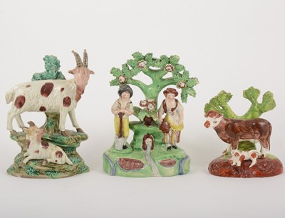 Lot 11-A Staffordshire pearl glazed earthenware group, gardeners by a fountain, early 19th century, and two bocage groups