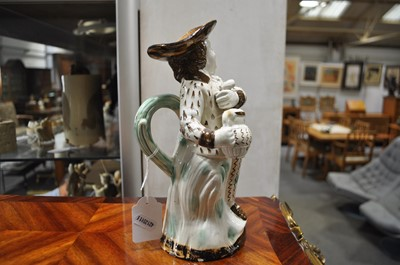 Lot 13-A Pearlware type earthenware 'Hearty Goodfellow' Toby jug, early 19th centur