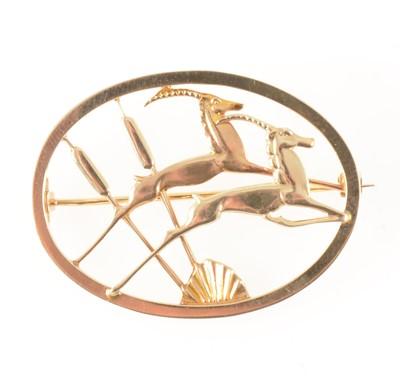Lot 76-Geoffrey Bellamy for Ivan Tarratt  a 9 carat yellow gold leaping gazelle brooch.