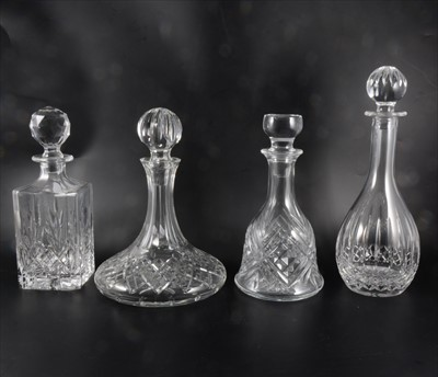 Lot 29-Four glass decanters, including Waterfords Crystal ships decanter, another Waterfords Crystal decanter, and two others.