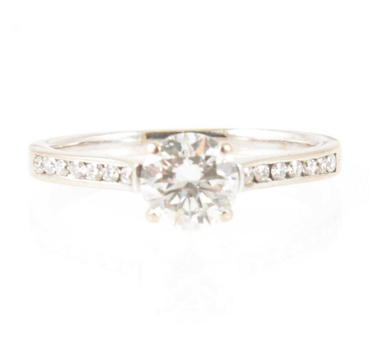 Lot 7-A diamond solitaire ring.
