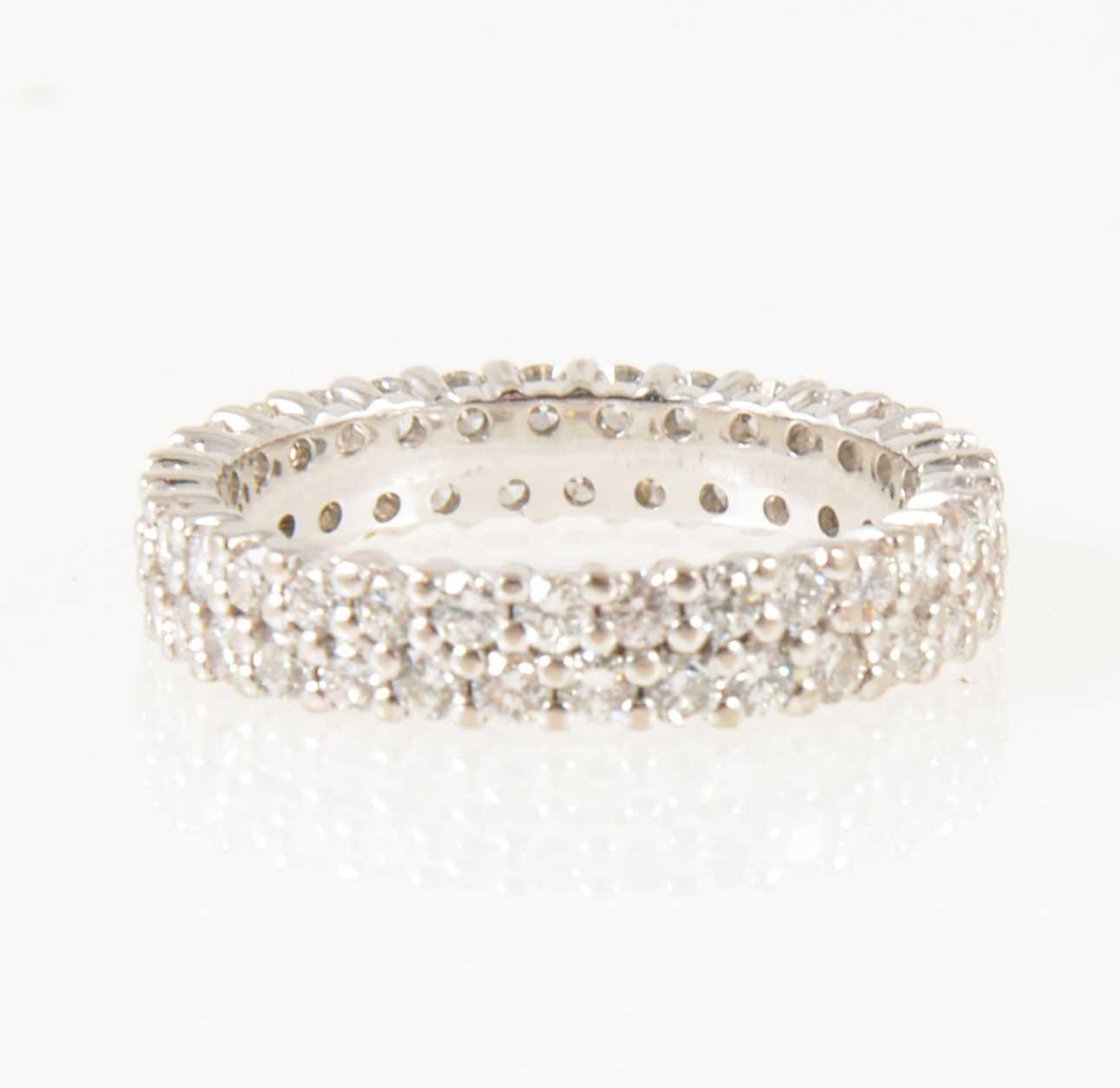Lot 13-A diamond two row full eternity ring,.