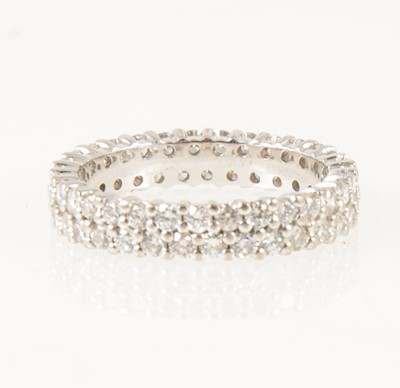 Lot 13-A diamond two row full eternity ring,.