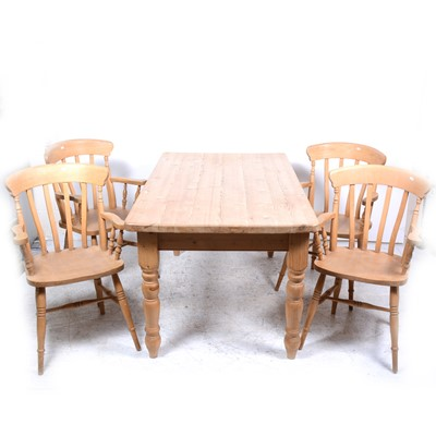 Lot 54-A modern pine kitchen table and four beechwood elbow chairs
