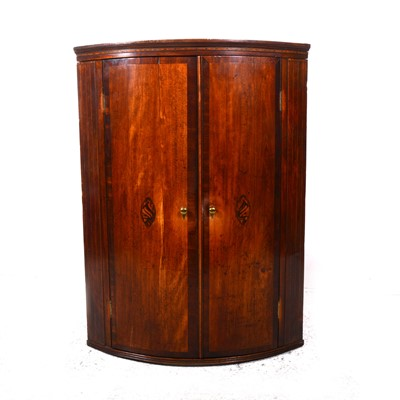 Lot 18-A George III oak and mahogany cylinder front hanging corner cupboard