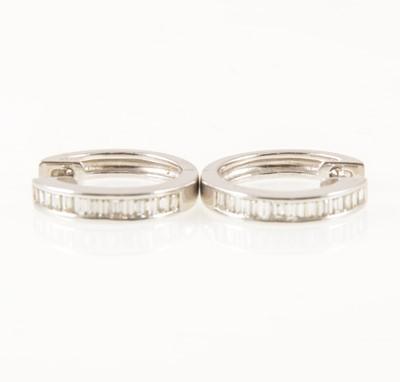 Lot 53-A pair of diamond hoop earrings.