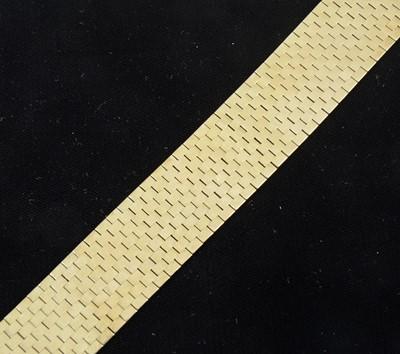 Lot 87-A yellow metal 26mm wide flexible brick construction bracelet.