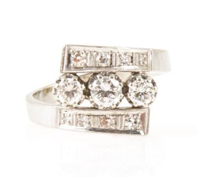 Lot 8-A diamond three row ring.