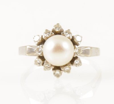 Lot 34-A pearl and diamond circular cluster dress ring.