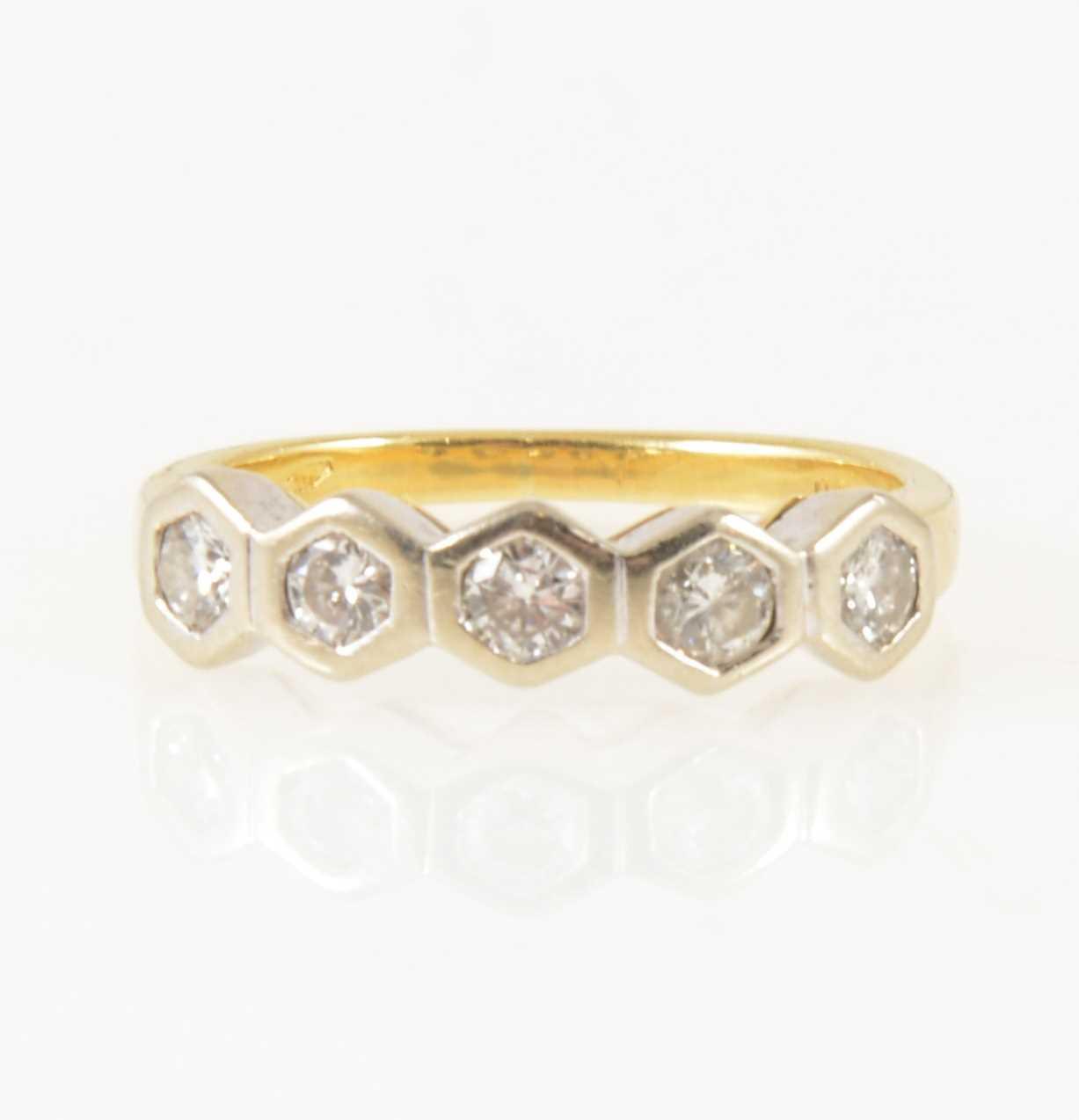 Lot 12-A diamond five stone ring.