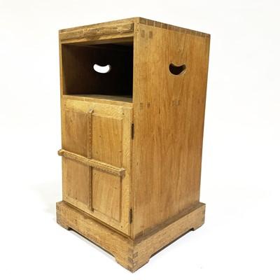 Lot 534-An Arts and Crafts oak bedside pedestal cupboard, by Peter van der Waals for Claude Biddulph