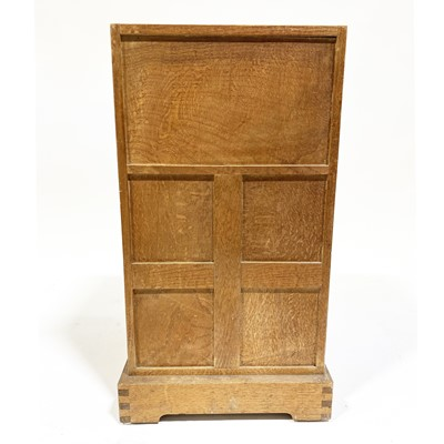 Lot 534-An Arts and Crafts oak bedside pedestal cupboard, by Peter van der Waals for Claude Biddulph