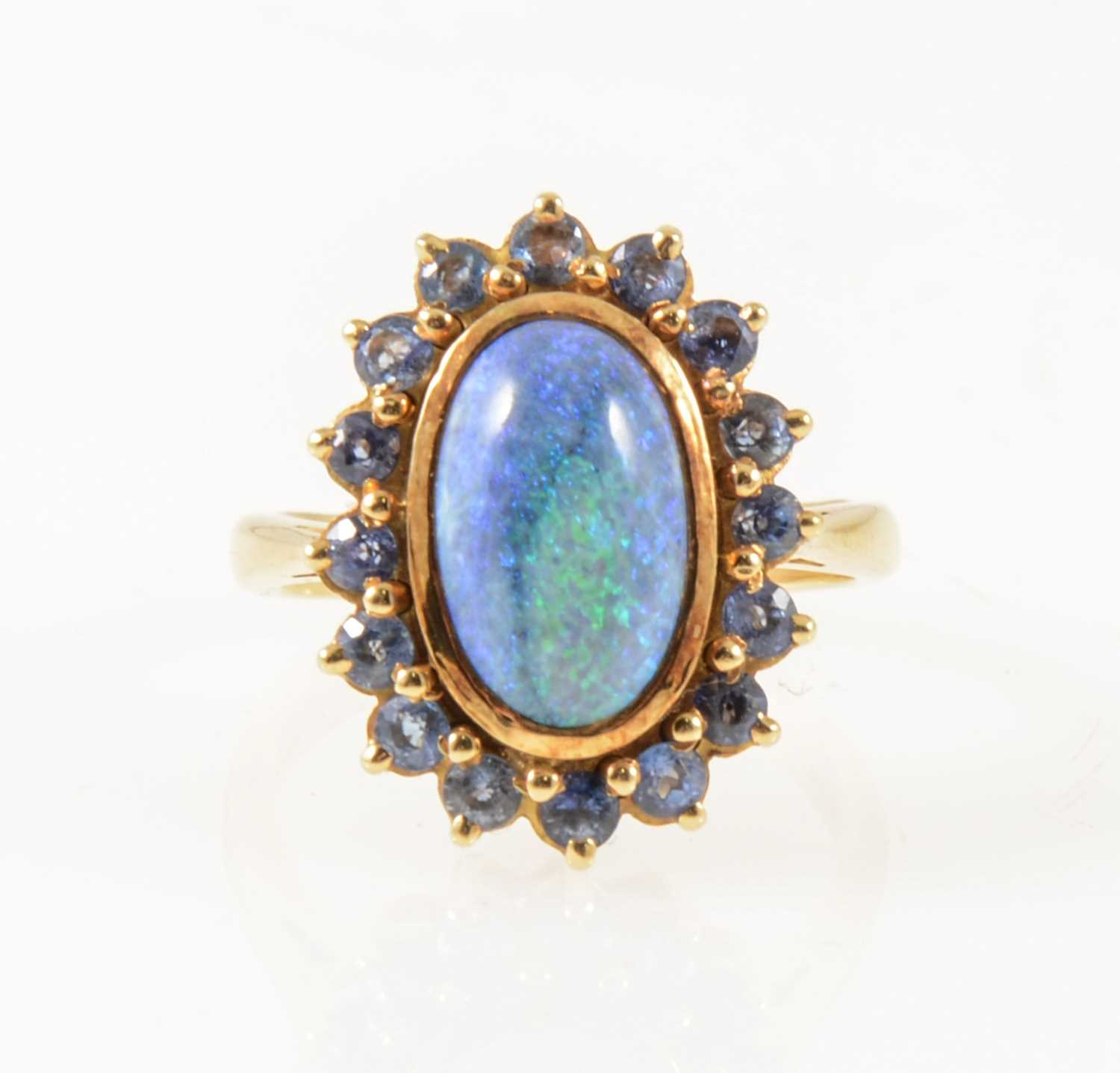 Lot 38-A black opal and sapphire dress ring.