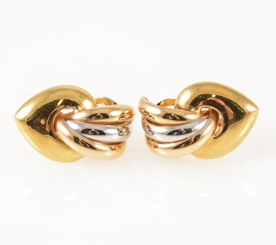 Lot 57-A pair of 18 carat yellow and white gold earrings.