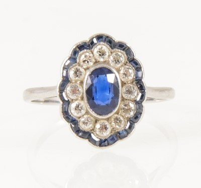 Lot 19-A sapphire and diamond oval cluster ring in the Art Deco style.