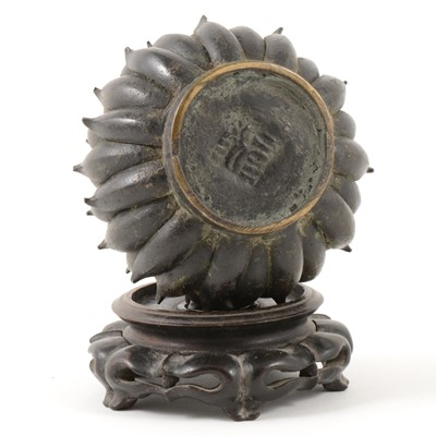 Lot 356-A small Chinese bronze censer, modelled as a Chrysanthemum head