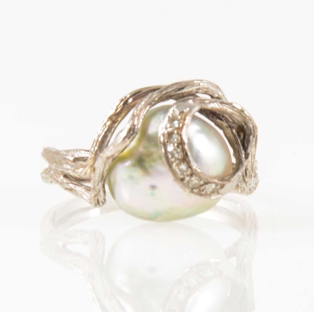 Lot 33-A pearl and diamond dress ring.