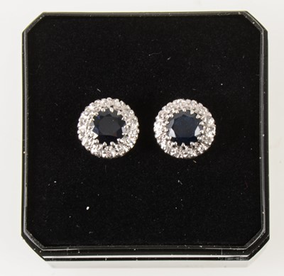 Lot 54-A pair of sapphire and diamond earstuds