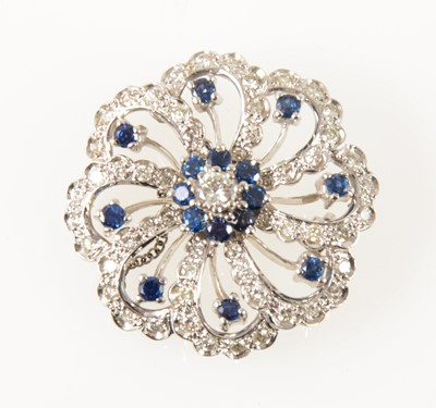 Lot 64-A sapphire and diamond brooch.