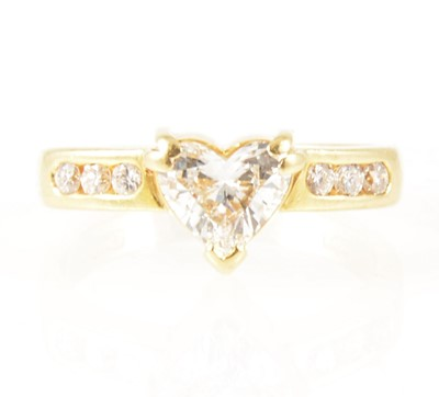 Lot 6-A heart shaped diamond ring with diamond shoulders.