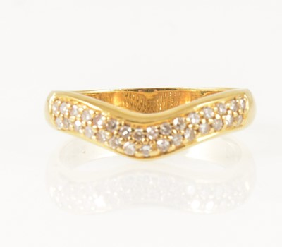 Lot 17-A diamond set wishbone ring.