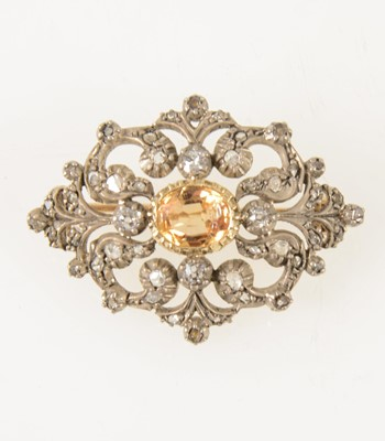 Lot 66-A late Victorian diamond brooch with golden yellow stone to centre