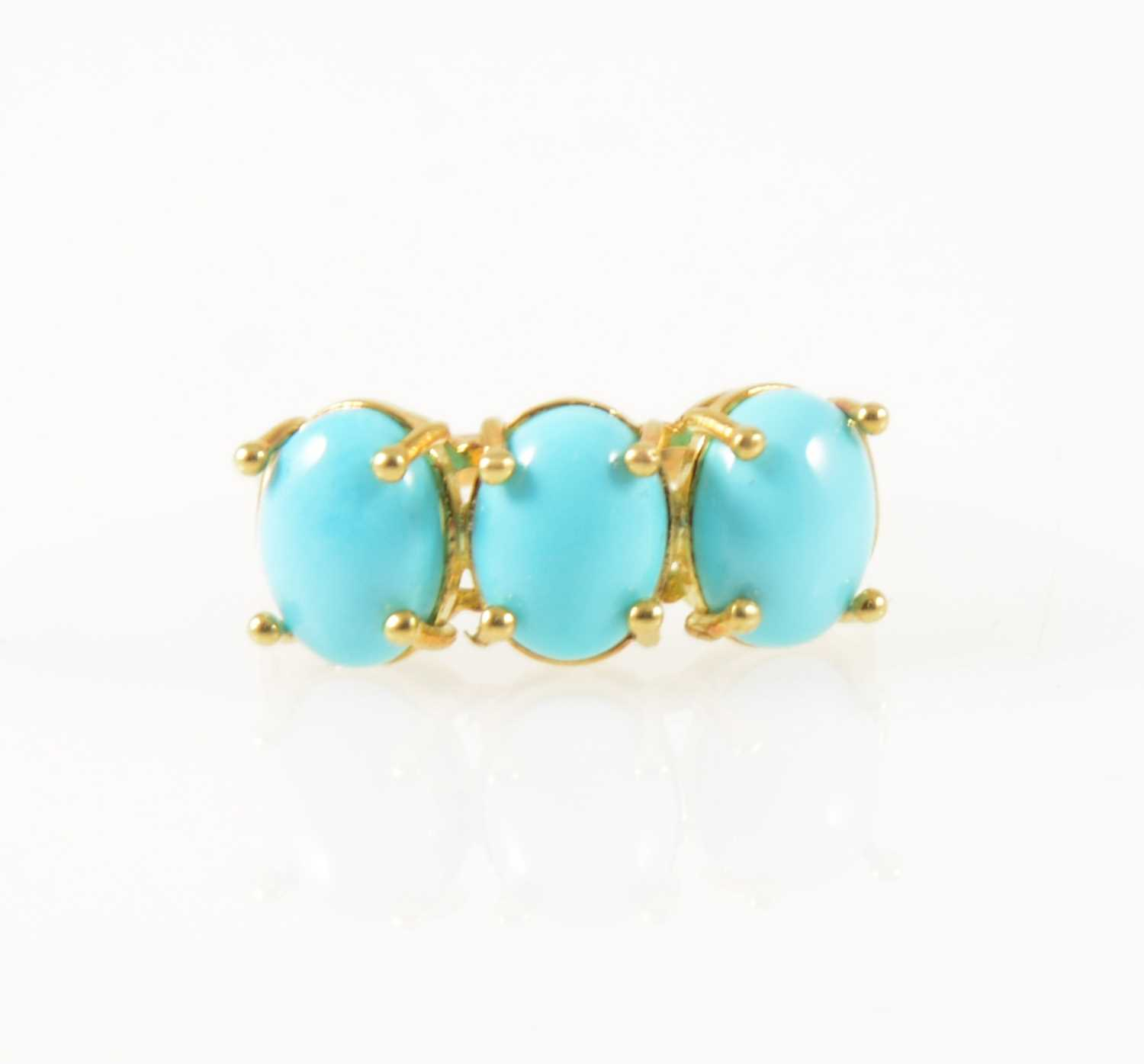 Lot 39-A turquoise three stone ring.