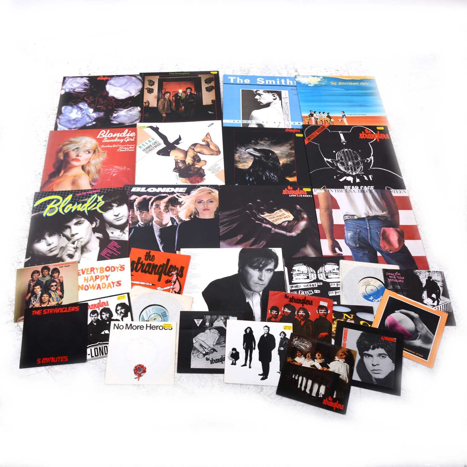 """Lot 15-Small selection of LP, 12"""" and 7"""" single records, including The Smith, The Stranglers etc."""