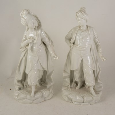Lot 1012-A pair of Continental porcelain figures of a courtesan and Ottoman fighter