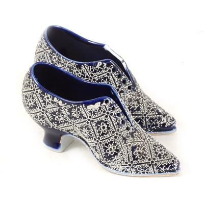 Lot 13-A pair of Continental porcelain miniature shoes