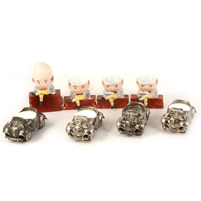 Lot 1026-Three novelty porcelain Humpty Dumpty egg cups, and  four silver plated Noddy Car egg cups