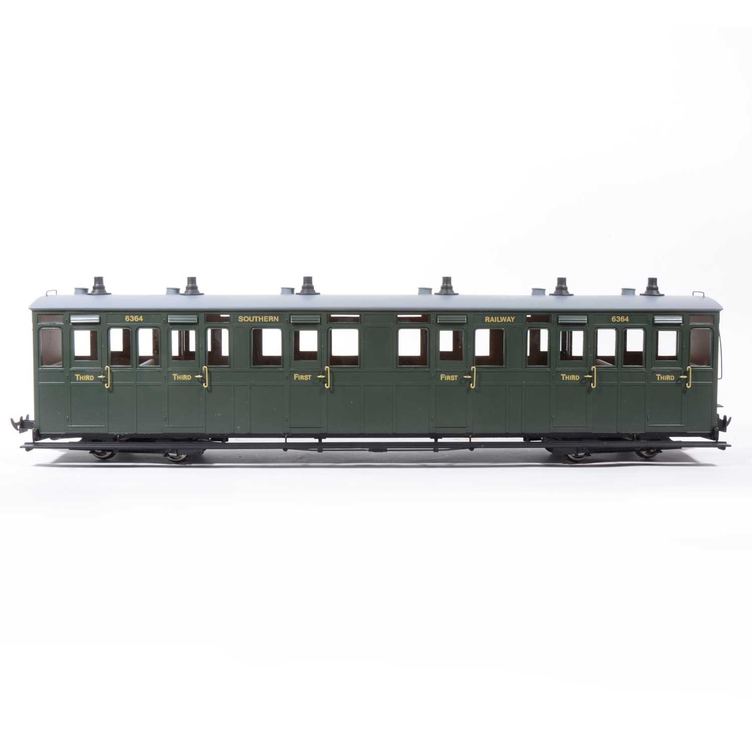 Lot 63-Accucraft G scale passenger coaches, Lynton & Barnst bogie R19-20, R19-21, R19-19, and a W&L Pickering coaches no.6338, all boxed.