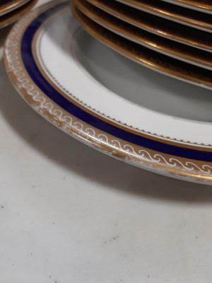 Lot 42-Grainger & Co. Worcester part dinner service, banded in Royal blue and gilt.