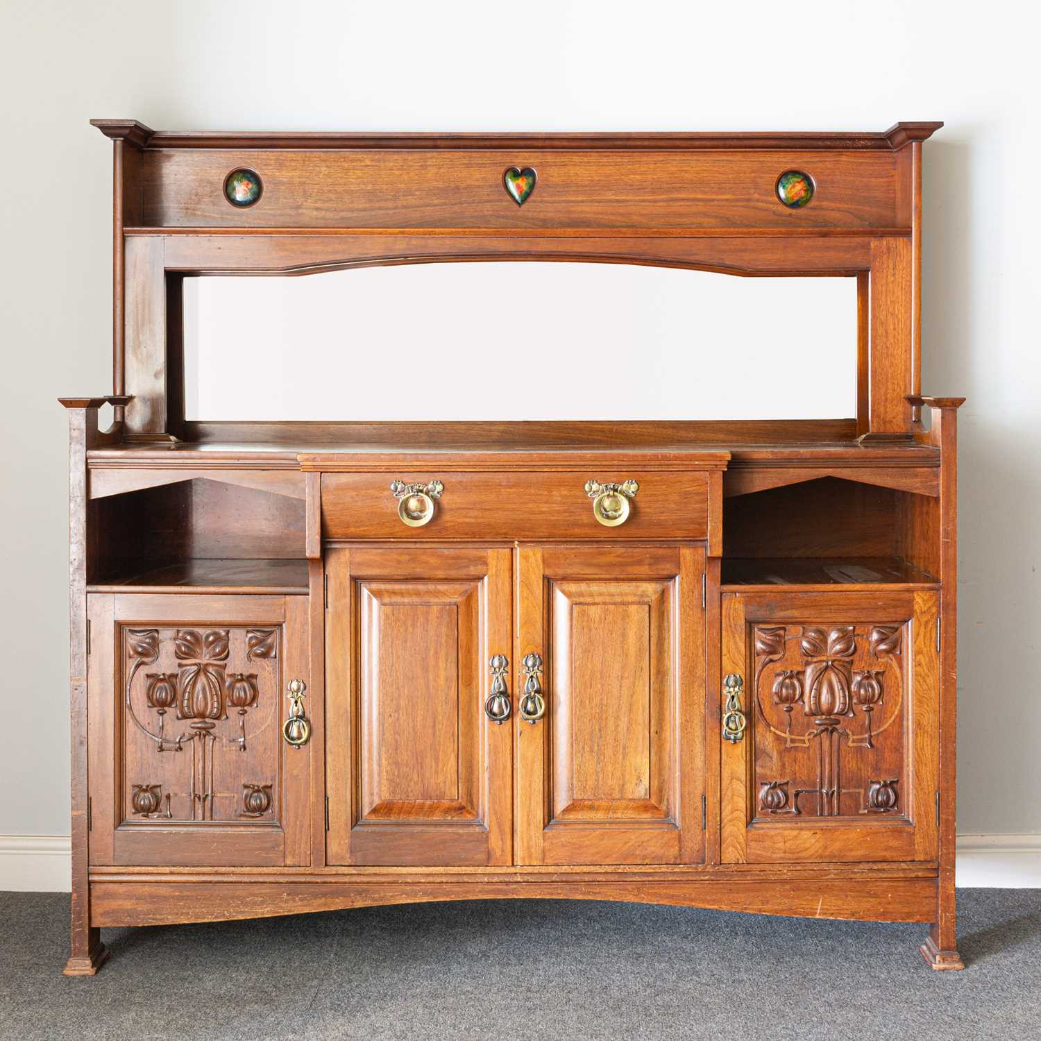 Lot 540-An Arts and Crafts walnut sideboard, by Shapland & Petter of Barnstaple
