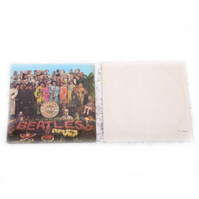 Lot 10-The Beatles White Album and Sgt. Pepper's Loney Hearts Club Band vinyl LP records.