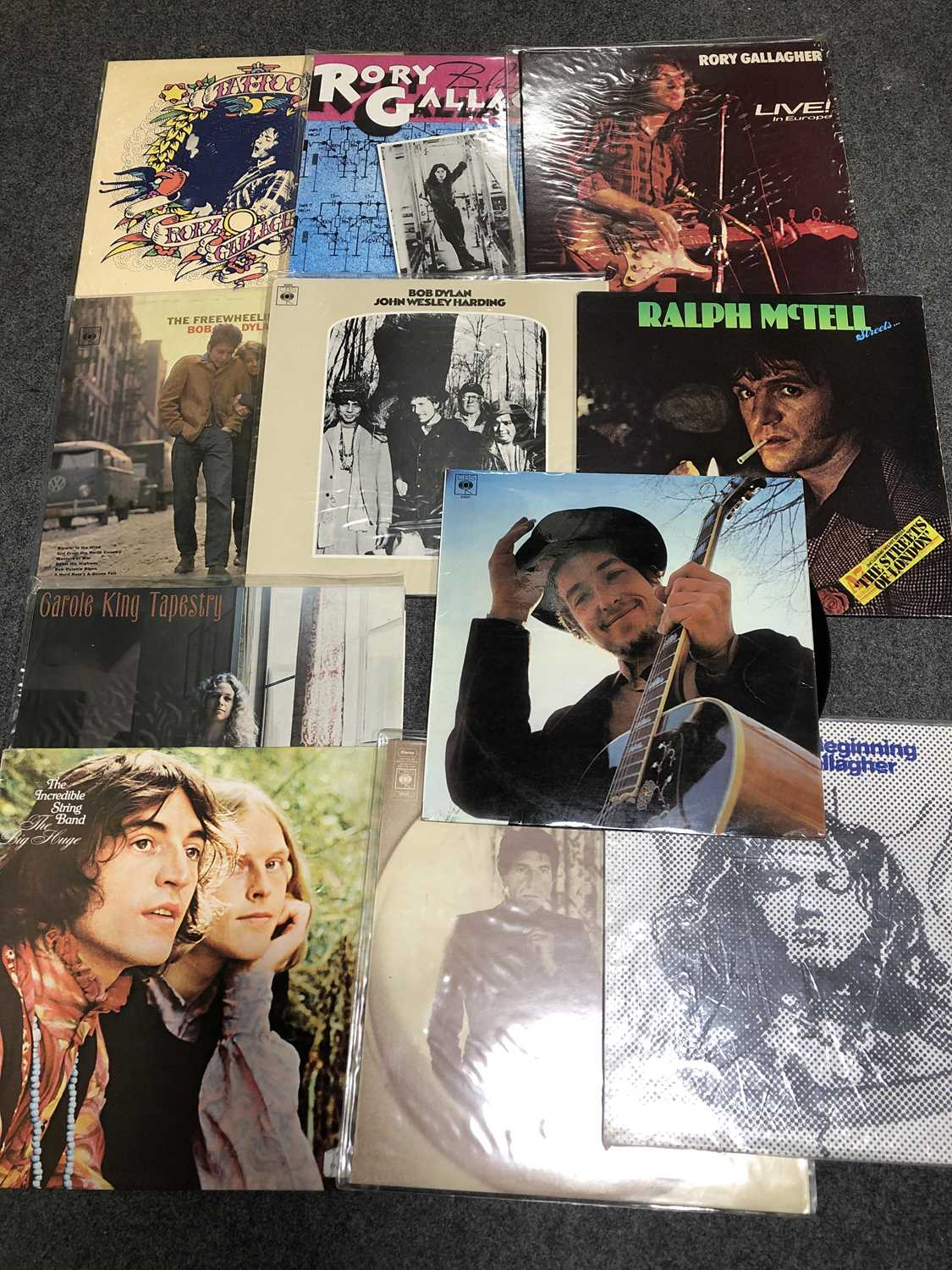 Lot 2-Eleven vinyl LP records mostly singer songwriter music; including Bob Dylan etc