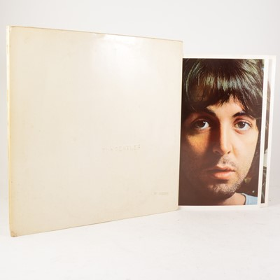 Lot 5-The Beatles White Album LP vinyl record; Mono pressing no.0021390, PMC 7067/7068, embrossed cover, top opening, with four portraits and poster.