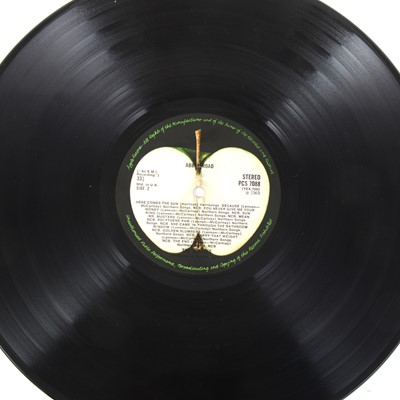 Lot 23-The Beatles Abbey Road LP vinyl record; Stereo PCS 7088 matrix 749-2/750-1, misaligned apple label, omitting 'Her Majesty' credit